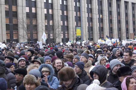 outrage: Russia, Moscow - DECEMBER 24:  120 thousands of protesters take to in Academician Sakharov Prospect  to protest Putin, calling for fair. The biggest protest in Russia for the last 20 years.
