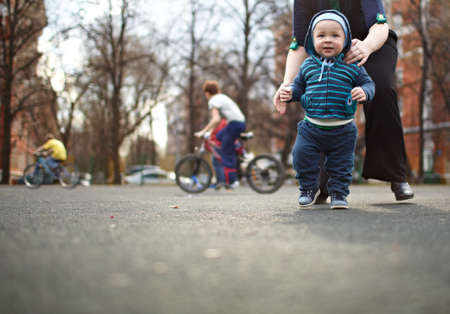 The first steps of the kid. Natural colors, shallow dof.