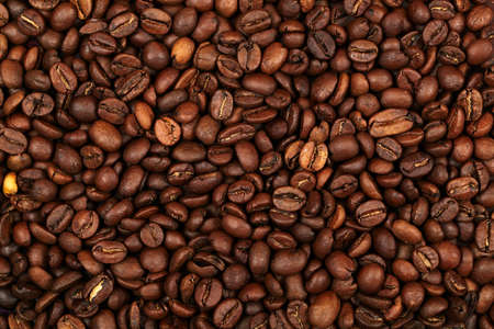 Coffee beans background. Natural morning light, excellent image quality. Stock Photo - 14048231