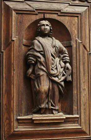 wood carving door: Wooden vintage figure