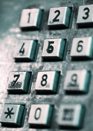 The buttons of an old-style street public telephone. Shallow depth of field. photo