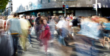 pedestrian: Busy people in casual clothes on the street.
