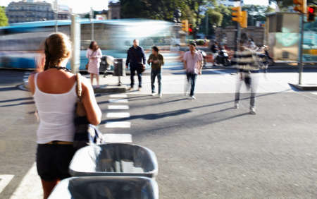 People crossing the road at the foot-crossing. photo