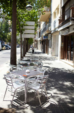 siesta: Empty street cafe in one of the Barcelonas street. Stock Photo