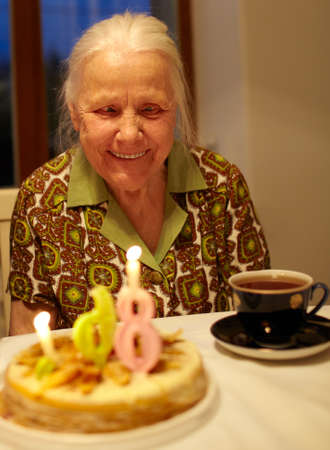 Kind grandmother is celebrating her 86th birthday at home. photo