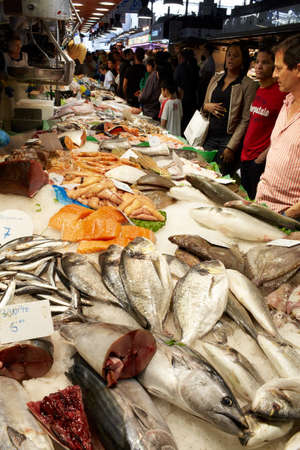 salespeople: BARCELONA - MAY 26  The buyers of fish at the market on May, 26, 2012 in Barcelona, Spain