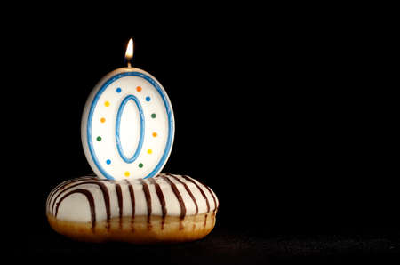 Candle 0 in the doughnut  Birthday background or the new beginnings concept  photo
