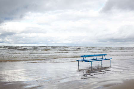 jurmala: Bench on the Baltic sea shore  Autumn landscape  Stock Photo