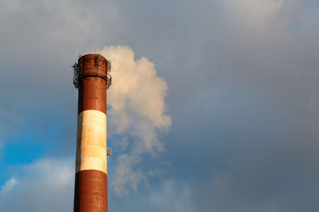 Color smoke comes out of the smokestacks at sunset  Air pollution  Stock Photo - 16675579