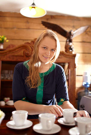 Young beautiful woman is making coffee in country house  photo
