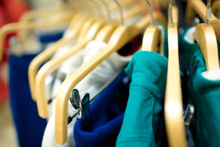 dof: Hangers in the clothes store  Shallow dof  Stock Photo