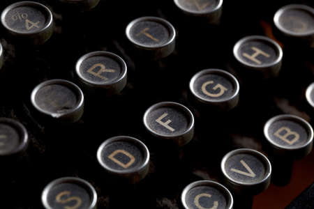 Close up photo of antique typewriter keys with dust, shallow focus Stock Photo - 16675575