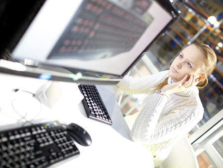 periphery: Young girl is choosing the keyboard in the online store  Stock Photo