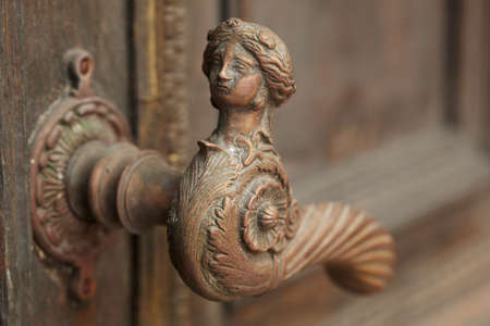 door handles: Vintage aged door handle in tallinn, estonia Stock Photo