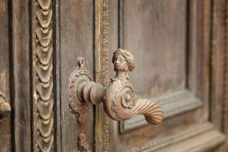 vintage aged door handle in tallinn, estonia photo