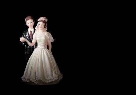 Wedding cake figurines on black Stock Photo - 17446747