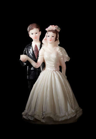Wedding cake figurines on black  photo