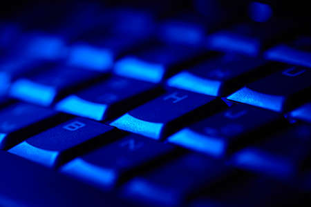 Computer keyboard in blue light  Small depth of field  Stock Photo - 18029392