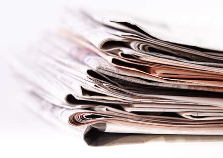 International newspapers on white background  Beautiful shallow dof  Stock Photo - 18237714