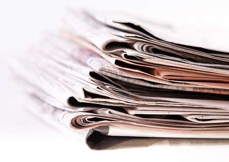 International newspapers on white background  Beautiful shallow dof  Stock Photo - 18237714