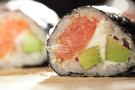 Susshi roll with salmon and avocado  Beautiful macro with shallow dof  photo