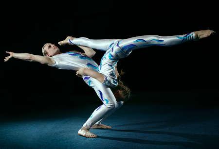 Circus artists perform different tricks  Gym split