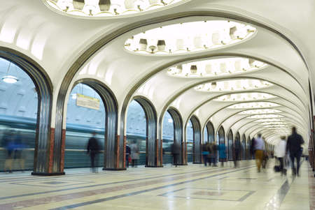 Motion blurred commuters at the metro station. Mayakovskaya station in Moscow underground. Beautiful arch architecture.