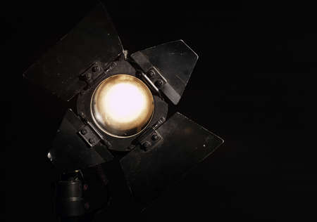 Studio floodlight on black background with warm tungsten light Stock Photo - 20691100