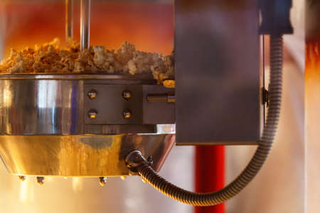 popcorn kernel: Machine for popcorn cooking. Close up with natural light. Stock Photo