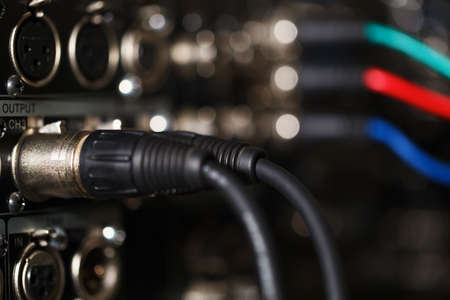 vcr: XLR audio digital cables in the rear panel of the professional VCR. RGB video cables in blur.
