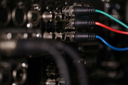 RGB video cables in the rear panel of the professional VCR. XLR audio cables in blur. photo