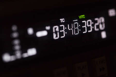 rec: Timecode running on the professional video recorder. Macro shot with perspective.