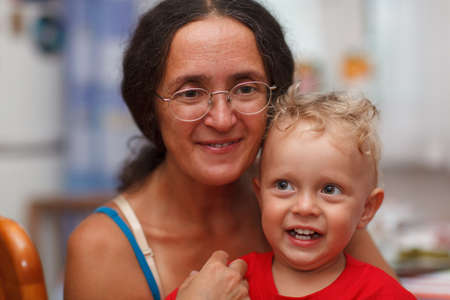 jewess: Forty years old mother with her son. Close up portrait.