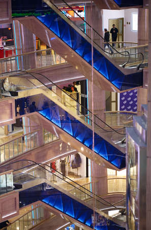 shopping centre: MOSCOW, RUSSIA - DECEMBER 18, 2013: Three escalators in shopping centre Rio in Leninsky Avenue. Interior decoration during Christmas holidays