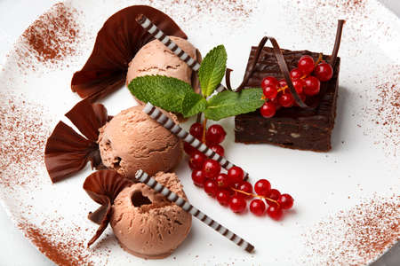 chocolaty: Restaurant dessert with chocolate ice-cream, cake and red currant decorated with chocolate chips