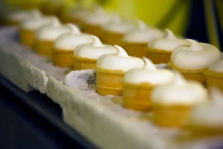 factory line: Close-up shot of moving conveyer with ice-cream cones ready for packing