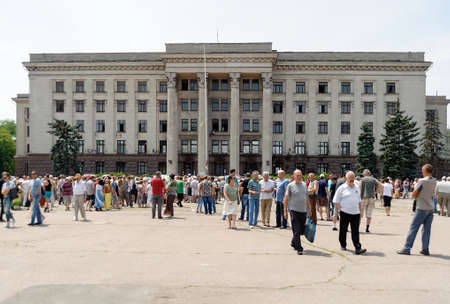 clashes: ODESSA, UKRAINE - JUNE 8, 2014: Commemorative meeting on the square in front of burnt Trade Unions House in Odessa. Ceremony was held in honor who died in 2 May 2014 Odessa clashes