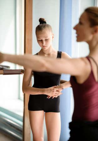 barre: Candid of ballerina standing looking at the floor