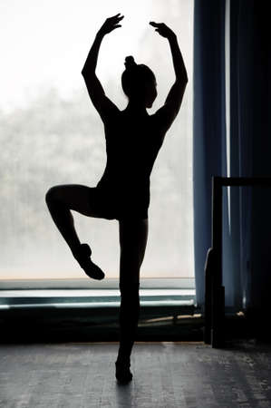 ballerina silhouette: Ballerina silhouette dancing in black and white Stock Photo