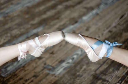 touching toes: Pointed feet in ballet shoes touching toes