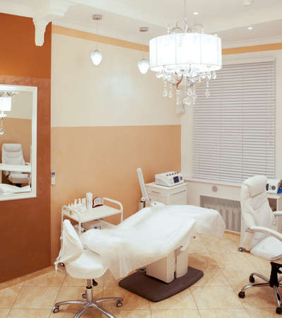 parlour: Interior of a beauty salon with a couch and equipment in a neutral decor of fresh white and shades of brown for skincare and consultations with a beautician and cosmetician