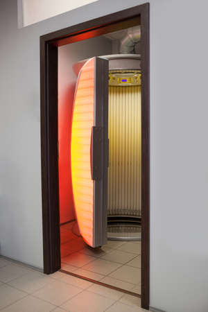 sunroom: Empty stand up tanning bed in another room