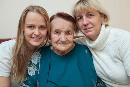 grandkid: Family portrait of three generations  Mother, daughter and grandmother smiling