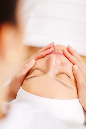 Close-up shot of a relaxed woman during professional facial massage Stock Photo