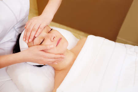 esthetics: Close-up shot of relaxed woman taking treatments of facial massage in at beauty spa Stock Photo