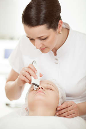 ultrasonic: Professional beautician providing ultrasonic facial cleaning at beauty treatment salon
