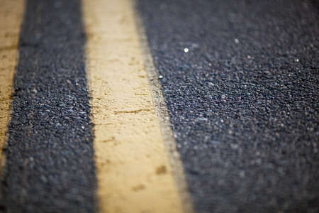 road surface: Close up of asphalt road with yellow marking Stock Photo