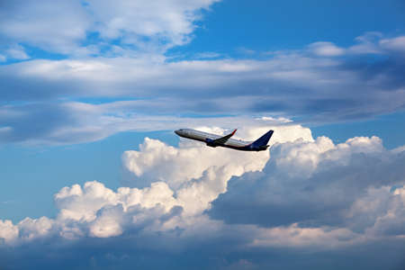 fly: Modern passenger airliner flying in the cloudy sky Stock Photo