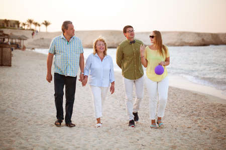 Happy senior and young couples having a walk at the seaside. Parents and adult children together outdoor Фото со стока - 42714507