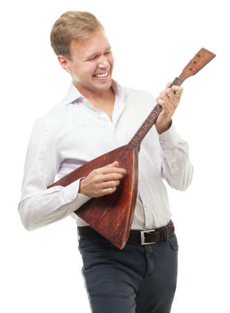 white russian: Happy young man playing balalaika, national Russian trichord musical instrument. Isolation on white background